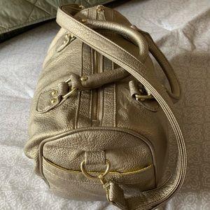 Steve Madden Distressed Gold Duffel Bag